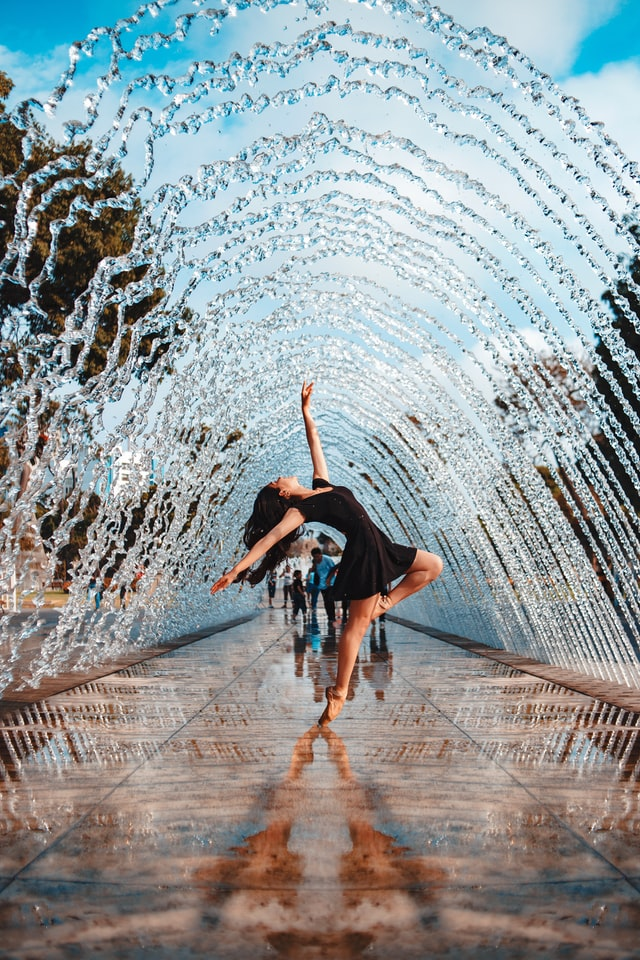confident person dancing in the water