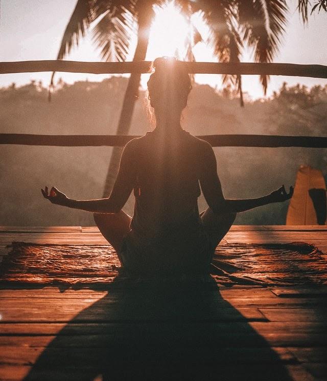someone meditating.
